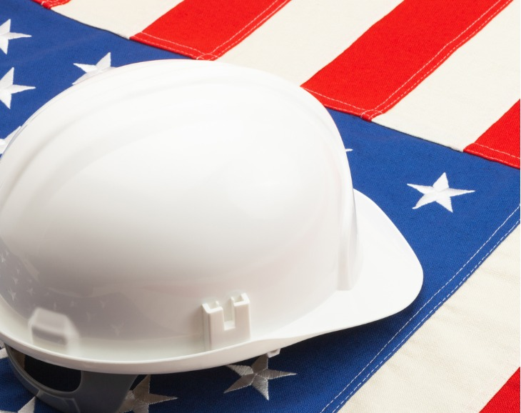 White hardhat on American flag