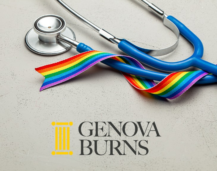 LGBTQ ribbon wrapped around a stethoscope